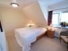 Ferienwohnung Dachgeschoss Schlafzimmer